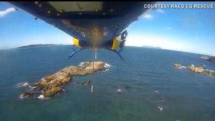 A message in the sand led a rescue helicopter to five stranded snorkelers.
