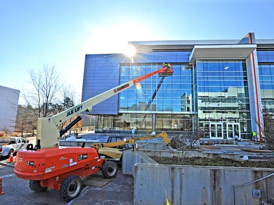 Construction crews are building a new office building