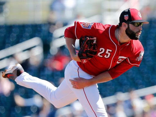 Cincinnati Reds pitcher Cody Reed (25) delivers a pitch