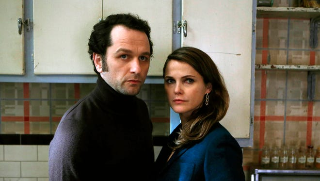 "Matthew Rhys, left, and Keri Russell appear in a scene from ""The Americans."""