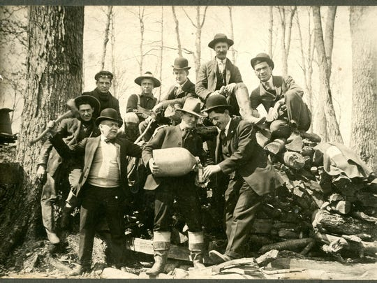 A group of friends stage a photograph joking about Prohibition, circa 1910.