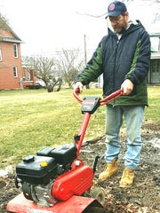 Brent Cosey of Marion checks out his rototiller in