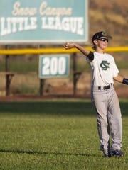 Britton Shipp throws the ball into the infield at the Santa Clara Little League Field in 2011.