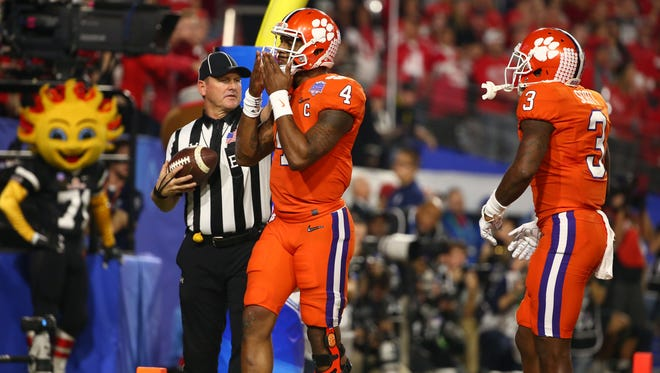 Clemson Tigers quarterback Deshaun Watson (4) reacts after scoring a touchdown against Ohio State during the first quarter of the College Football Playoff Semifinal game in the PlayStation Fiesta Bowl on Dec. 31, 2016 at University of Phoenix Stadium in Glendale, Arizona.