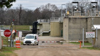 A van drives through the City of Jackson wastewater treatment facility Wednesday, Dec. 27, 2017. The Environmental Protection Agency Ñ in its consent decree with Jackson Ñ mandated the city clean up sewage sludge materialÊat the Savannah Wastewater Treatment Facility in the event flooding occurred and washed it into the Pearl River.