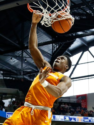 Tennessee forward Admiral Schofield (5) watches his dunk against Ole Miss during the first half of an NCAA college basketball game in Oxford, Miss., Saturday, Feb. 24, 2018.