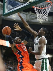 Michigan State's Leron Black looks to shoots over Michigan