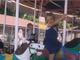 Gabrielle and Jordan riding a carousel at Marathon