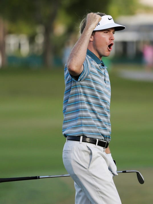 Russell Henley celebrates as he tied for the lead by chipping in for birdie on the 14th hole during the final round of the Honda Classic golf tournament, Sunday, March 2, 2014 in Palm Beach Gardens, Fla. Henley won the tournament in a four-man playoff. (AP Photo/Wilfredo Lee)