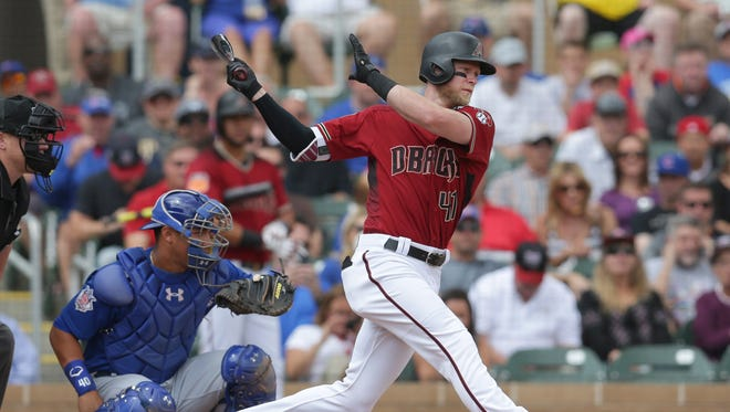 Arizona Diamondbacks right fielder Jeremy Hazelbaker swings during a spring training game March 23 against the Chicago Cubs at Salt River Fields at Talking Stick.
