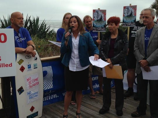Corry Westbrook, former federal policy adviser for Oceana, speaks Wednesday at a rally against oil exploration and drilling in the Atlantic.