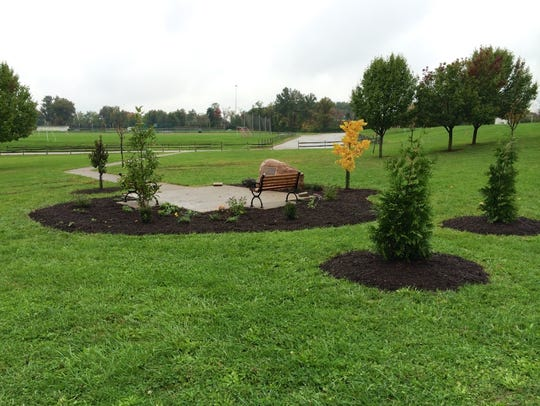 Volunteers planted flowers and shrubbery around the