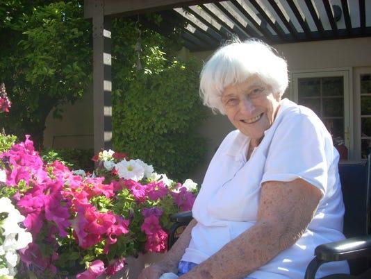 635703175793770838-Mom-in-her-garden