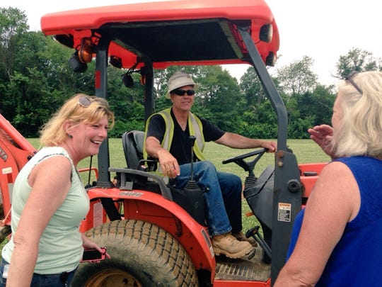 Birches teachers Lauri Bronson (left) and Bettiann Young talk laugh with South Jersey Gas machine operator Anthony Molino.