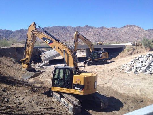 Two  excavators  work on the wash on Wednesday, July