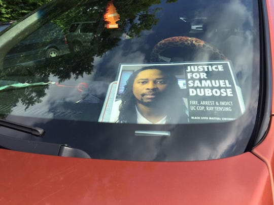 A sign with a picture of Samuel Dubose at the visitation