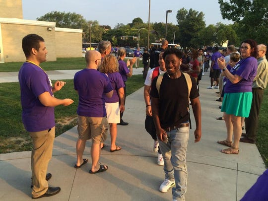 Students arrive for first day of school at East High School.