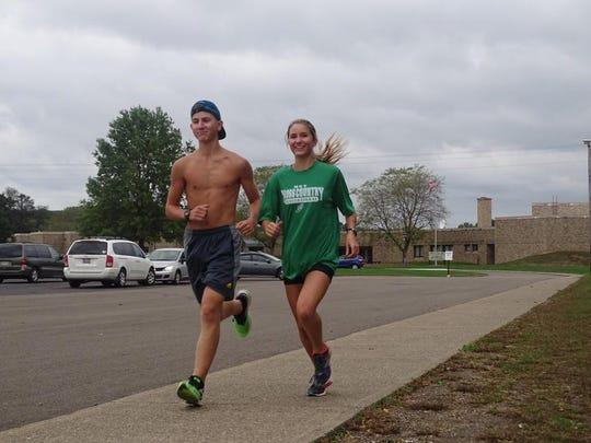 Caleb and Bella warm up before practice last week.