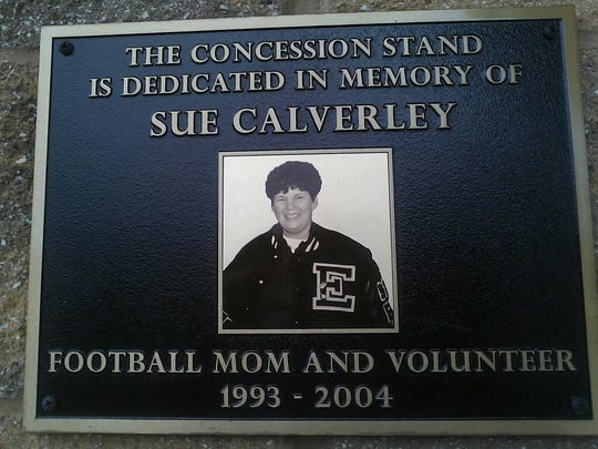 A plaque for Sue Calverley adorns the side of the concession stand at East Lansing High School's Lynn C. Adams Stadium.