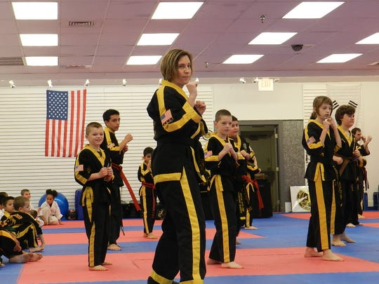 'it's easy for kids to go one way and their parents to go another,' says Kathy O'Callaghan, a second-degree black belt. 'But this is family time.'