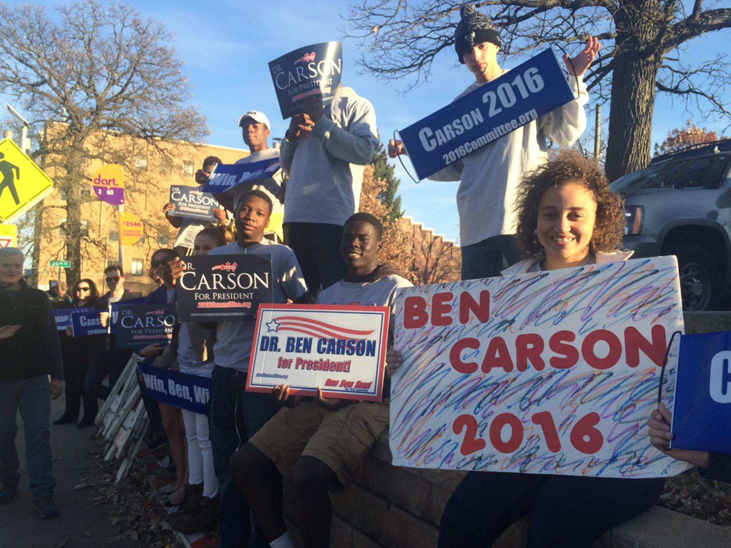 Ben Carson supporters from the super PAC Win Ben Win rally outside of Drake University Saturday.