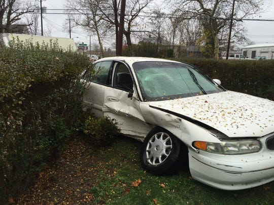 A Buick crashed through hedges after a collision Thursday