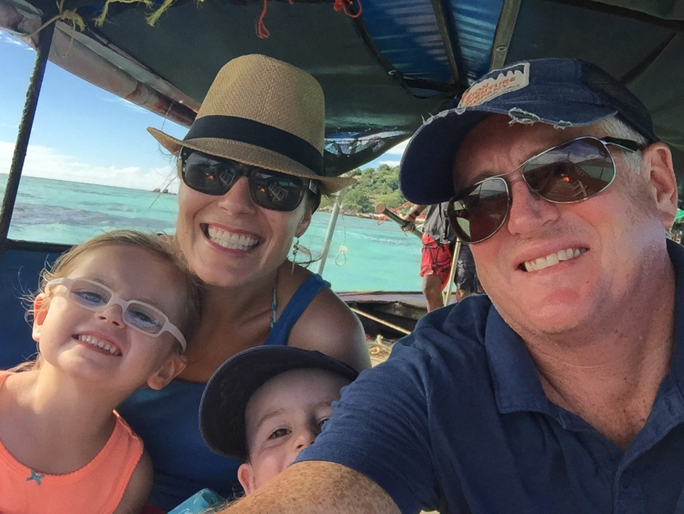 The Hughey family onboard a longboat in the Andaman