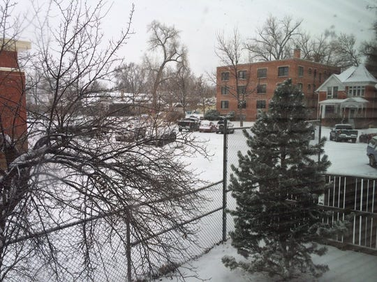 More than 4 inches of snow fell overnight Thursday in the Fort Collins area, according to the National Weather Service in Boulder. Fort Collins could see another 2 to 5 inches throughout the day. Snow blankets an Old Town East street Thursday morning in this photo.