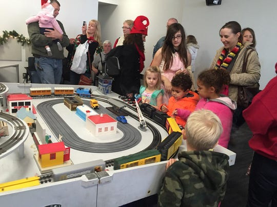Children examine a train display at The Evening Sun's open house Nov. 27.
