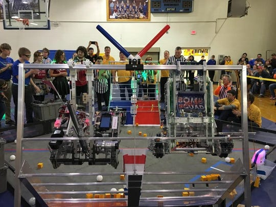 This photo taken Saturday, Dec 5, 2015 shows the Junior Bomb Squad robot, left, and the Bomb Squad Special Unit hanging side by side at the end of the final match during the championship tournament at Mountain Home Junior High School.