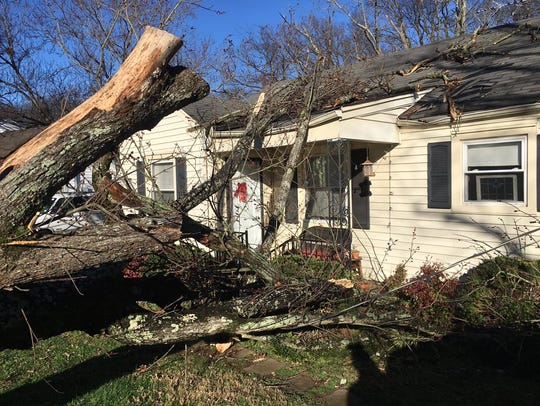 Storm damage at a home off Thompson Lane near I-24