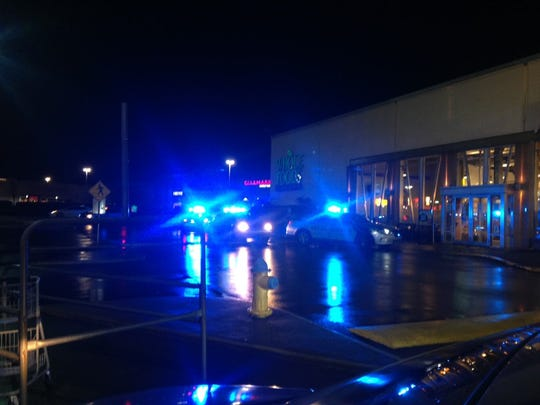 Police cars encircle the area near St. Matthews Mall where a large number of disturbances reportedly took place
