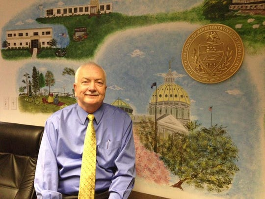 Former Republican state Rep. Ron Miller sits in front of a mural in his Springfield Township district office shortly before retiring from politics.