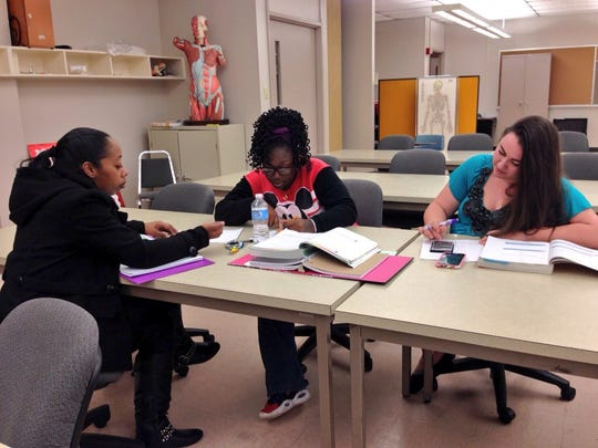 Practical nursing students Lekiesha Barns (left), Tylisha Robinson and Theresa Lacaze work on pharmacology problems Monday on the first day of the spring semester at Central Louisiana Technical Community College in Alexandria.