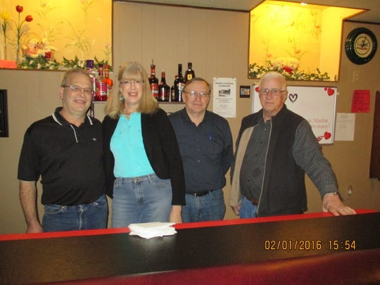 From left are Paul and ginger Stephanie, owners of the Cabaret, and Dan Dreifuerst and Sylvester Petrie, who are assisting with the centennial.
