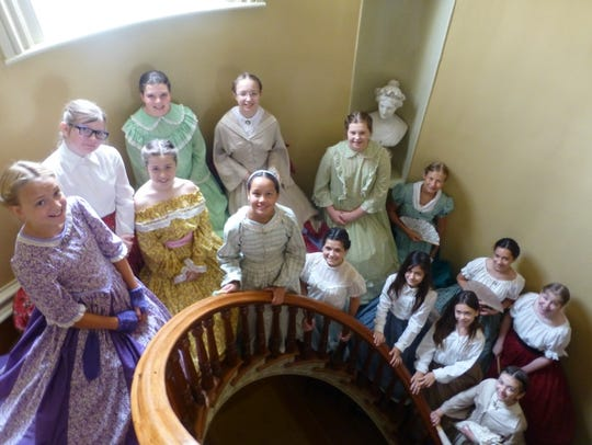 Girls dress in period attire during the Oaklands Mansion