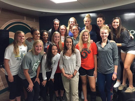 The CSU women's basketball team spent time with Becky Hammon, middle of front row, before the season began. The Rams can tie Hammon's 1998-99 team's school record for longest win streak with a victory Saturday.
