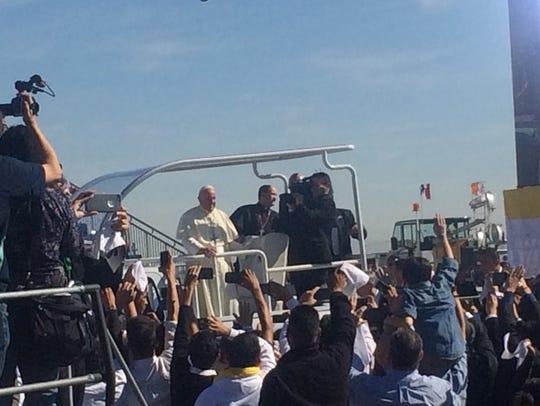 Pope Francis on the popemobile in Juárez.