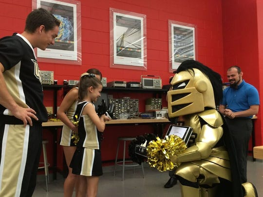 Knightro presents 10-year-old Julianna Linton with