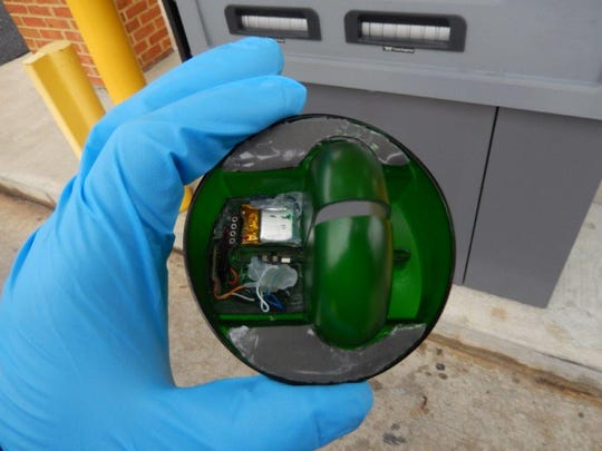 """Pictured is an illegal """"credit card skimmer"""" found on an ATM. The device is used to steal personal banking information from customers."""