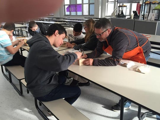 Tom Wolfe, who is the manager of the Home Depot store in Freehold, supplied a project for the Old Bridge High School students and taught them how to construct tool boxes.