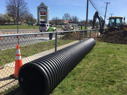 Cumberland County Public Works crews work on drainage