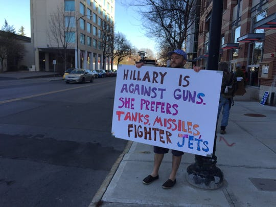 As people gather at Coltivare Monday morning to hear Chelsea Clinton campaign for her mother, Democratic presidential candidate HIllary Clinton, others gathered outside the restaurant to protest.