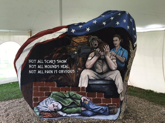 "One of the recent rocks painted by Ray ""Bubba"" Sorensen"