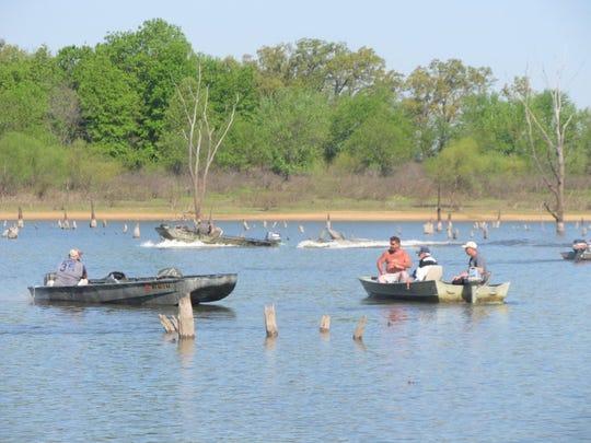 Before sunrise, more than a  dozen boats were already