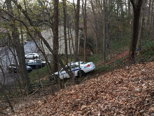 A Rochester Police Department vehicle landed down a hill past Almay Road.