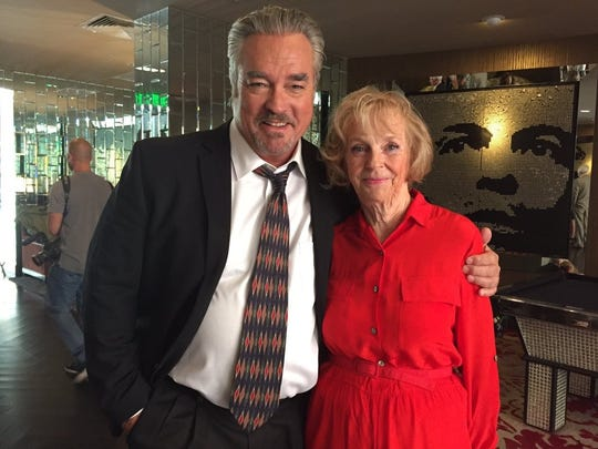 """Actor John Callahan with Connie Taylor on the set of the 2016 film """"Do It or Die."""""""