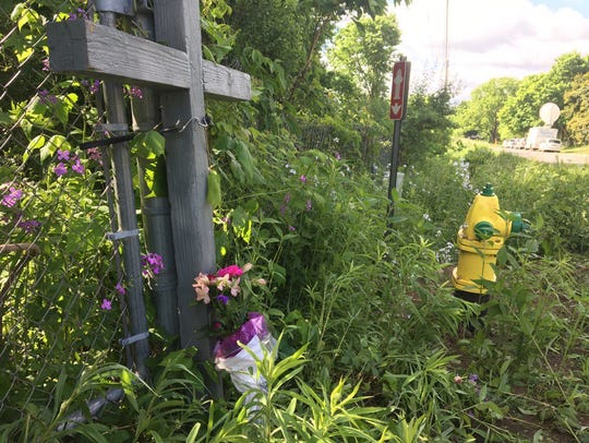 Cross, flowers mark scene north of Kalamazoo where
