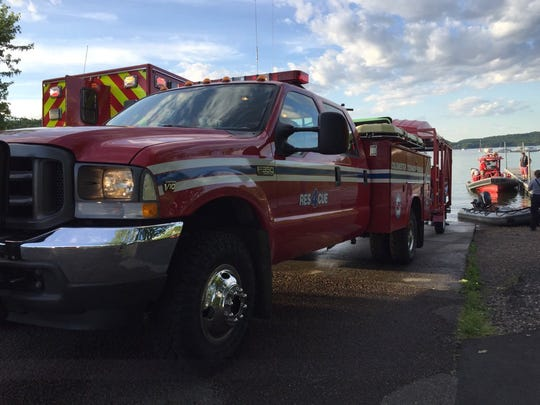 Rescue trucks and boats respond to reports of a boat collision on Malletts Bay on Wednesday night.
