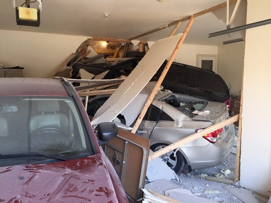 A car smashed into the garage of a duplex and damaged